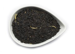 A premium fair trade black tea with calendula petals is pictured in a white tear drop shaped bowl in this fragrant and delicious organic Mango Ceylon Tea from OrganicTeasCanada.com.