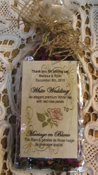 White wedding day tea favour is presented from Organic Teas Canada dot com.  A lovely hand made wedding shower favour with a natural burlap tie, great price for visibly quality gift!  One can see the free personalized label, the perfect organic tea favour gift to present to your wedding guests on your Special Day.