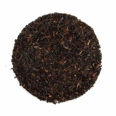 Organic Teas Canada picture of strong Assam broken leaf black tea displayed on a white background for this certified organic and fair trade reasonably priced inexpensive tea.