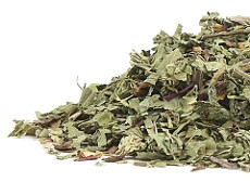 A pile of fresh and healthful dried organic Dandelion Leaf herb on a white background. Organic Teas Canada supplies organics free from sulphites, sanitary gases and irradiation.