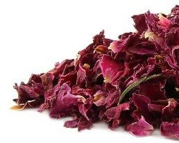 Beautiful fresh and fragrant dried red rose petals contrast a crisp white background.  Organic teas Canada dot com offers wonderful fresh organic herbs with no gluten, no sulphites and no irradiation.